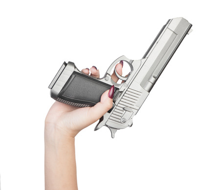 Pistol in female hand isolated on white background Stok Fotoğraf