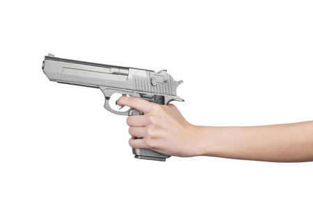 Pistol in female hand isolated on white background Stock Photo