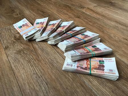 Stack of bills in packs of Russian ruble money on the floor Imagens