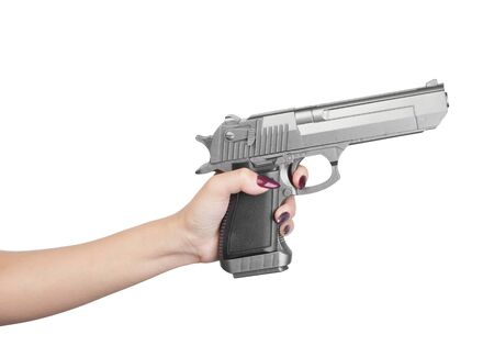 Pistol in female hand isolated on white background 免版税图像