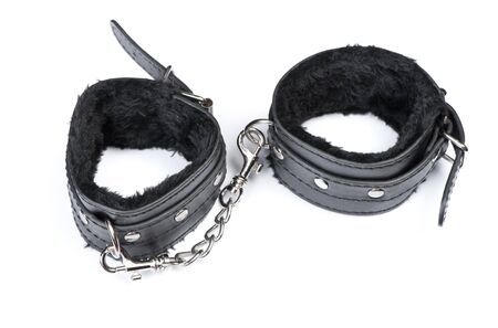 Pair of a black fetish leather handcuffs for BDSM isolated on white background