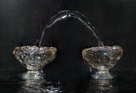 Flowing water in the glass Stock fotó