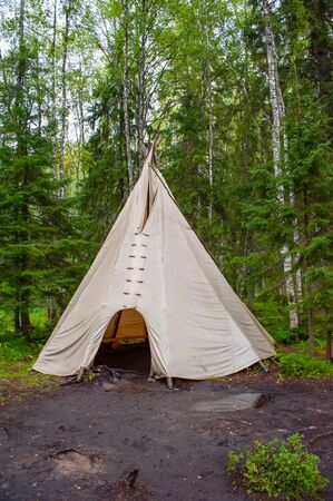 Wigwam teepee in the forest