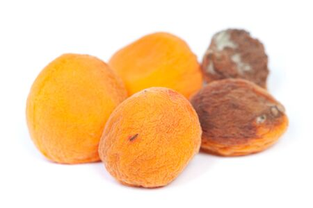 Group of rotten apricots isolated on white