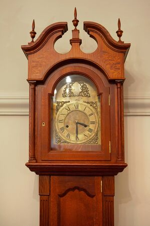 Old beautiful vintage brown wall clock
