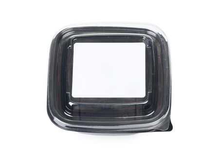Empty black plastic disposable take out container for food isolated on white background
