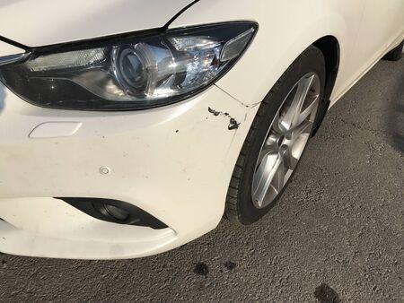 Dent car scratch close-up. Crashed car in accident 版權商用圖片