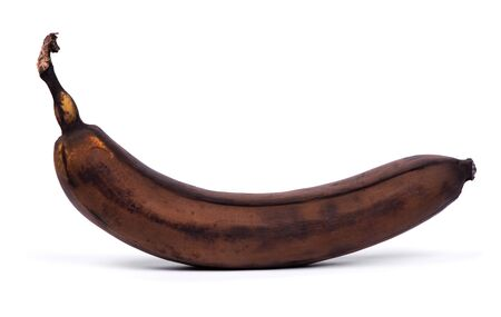 One black overripe banana isolated on white background