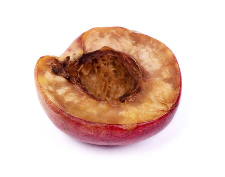 Half of rotten nectarine isolated on white background
