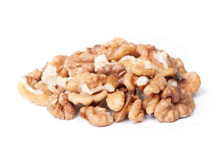 Heap of peeled walnut isolated on white background