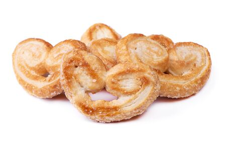 Group of puff pastry cookies with sugar isolated on white background