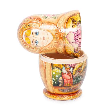 "Russian folk wooden nesting doll ""matrioshka"" isolated over white background"