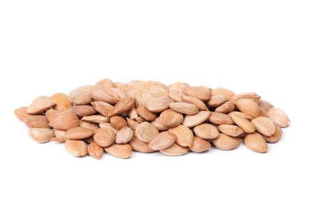 Handful of peeled apricot kernels isolated on white background