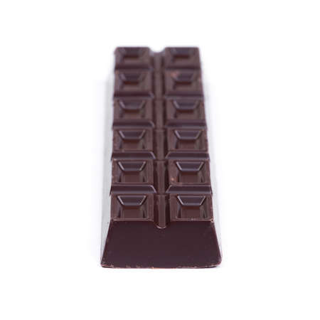 Thick long bar of chocolate isolated on white background