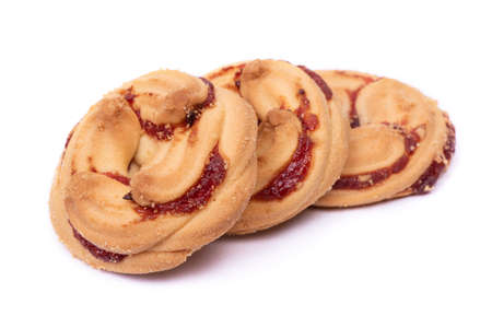 Group of shortbread cookies decorated with jam isolated over white background