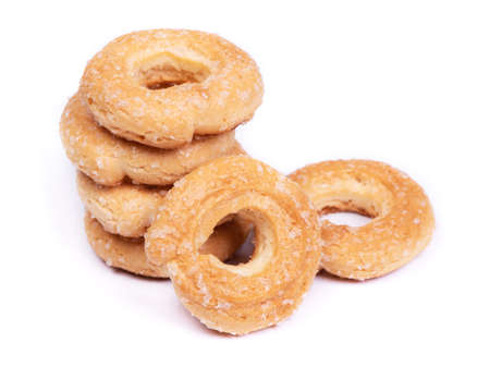 Group of dried donuts, ring-shaped pastry isolated over white background
