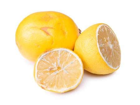 Spoiled lemon isolated on white background