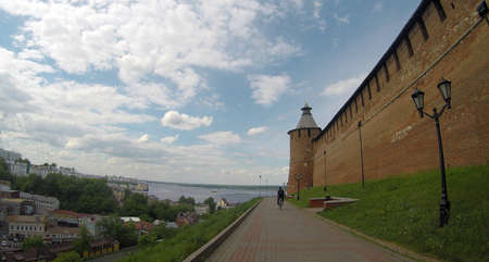a cyclist rides along the Kremlin. Nizhny Novgorod. Russia Stock Photo