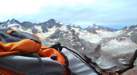 tourist backpack against the backdrop of the mountains