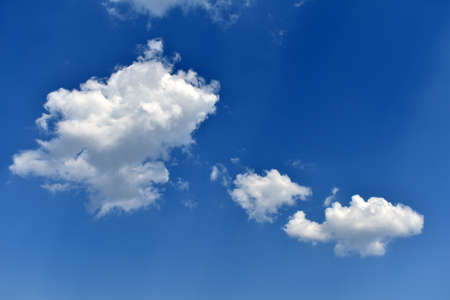 white clouds fly across the blue sky