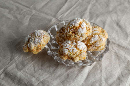 Homemade cookies on a table with a linen tablecloth