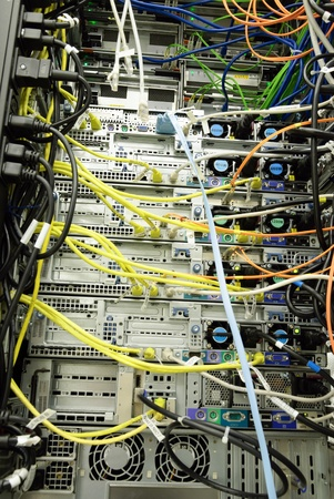 Picture of an messy backside of server rack. photo