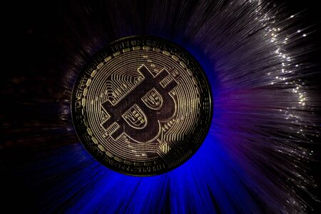 Bitcoin gold coin with beautiful backlighting