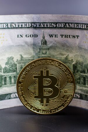 Bitcoin coin on a background of dollars