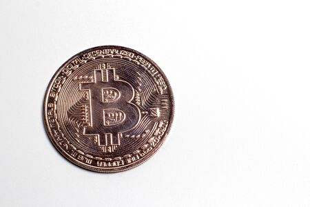 Bronze bitcoin on a white background