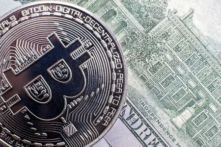Silver bitcoin on a background of dollars Stok Fotoğraf