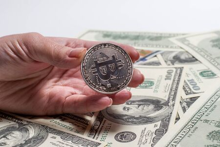 Bronze Bitcoin on a background of dollars