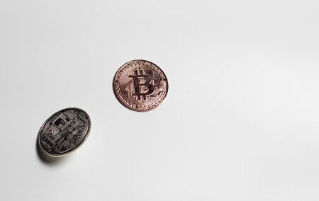 Two bitcoins on a white background