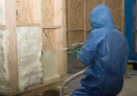 Worker insulates with a special foam wall