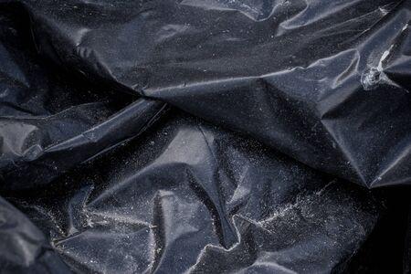 Black plastic crumpled garbage bag Reklamní fotografie
