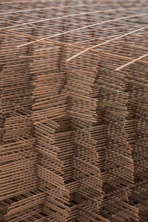 Metal mesh for reinforcing concrete floor and concrete surface at a construction site Stock Photo
