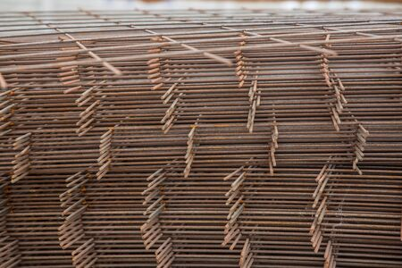 Metal mesh for reinforcing concrete floor and concrete surface at a construction site Foto de archivo