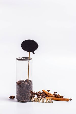 Coffee beans in a plastic jar on a white background Archivio Fotografico