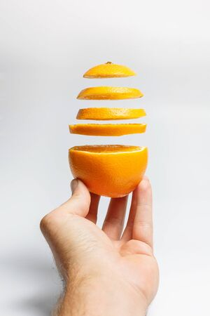 Sliced lime and lemon on a white background