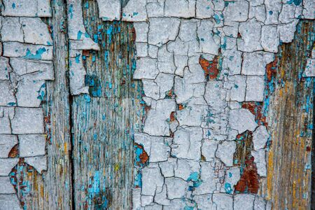 Texture with old peeling paint on a wooden surface