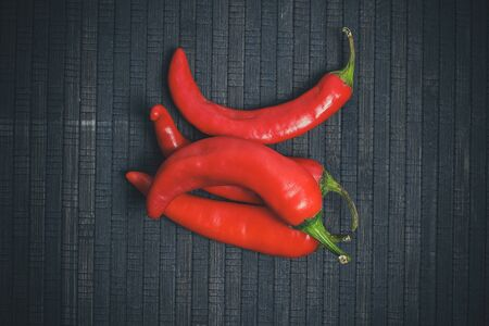 Hot peppers for spicy dishes on a black background Stock fotó