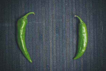 Hot peppers for spicy dishes on a black background