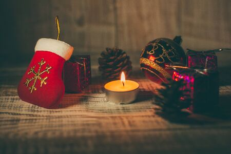 Christmas toys to decorate the holiday tree on a wooden white table