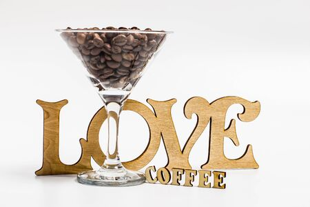 Coffee beans in a martini glass on a white background 스톡 콘텐츠