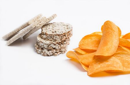 Harmful potato chips and healthy weight loss products on a white background