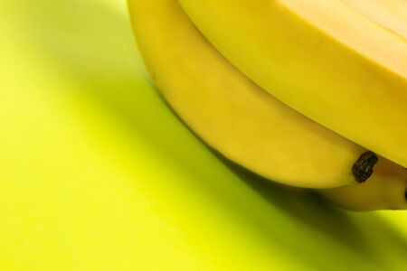Ripe banana for diet and sports on a green background close Stock Photo
