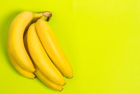 Ripe banana for diet and sports on a green background close 版權商用圖片