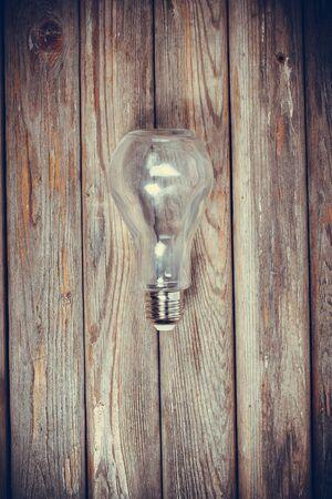 Empty bulb shaped bottle on vintage surface Foto de archivo