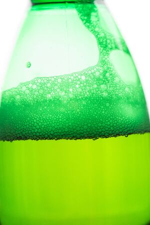 Beer with bubbles and foam in a green bottle Stock fotó