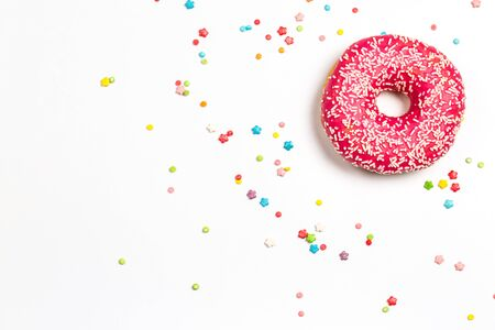 Tasty pink donut with sweet powder for the holiday on a white background