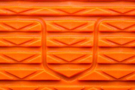 Bright Orange Rubber Textured Shoe Tread Surface